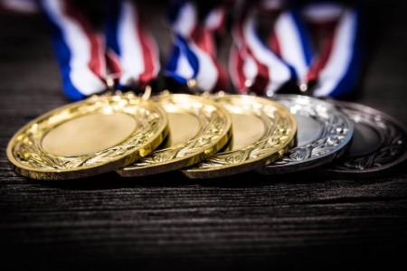 EY - Metal medal on black background