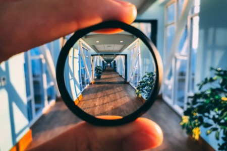EY - Magnification glass up to sky bridge