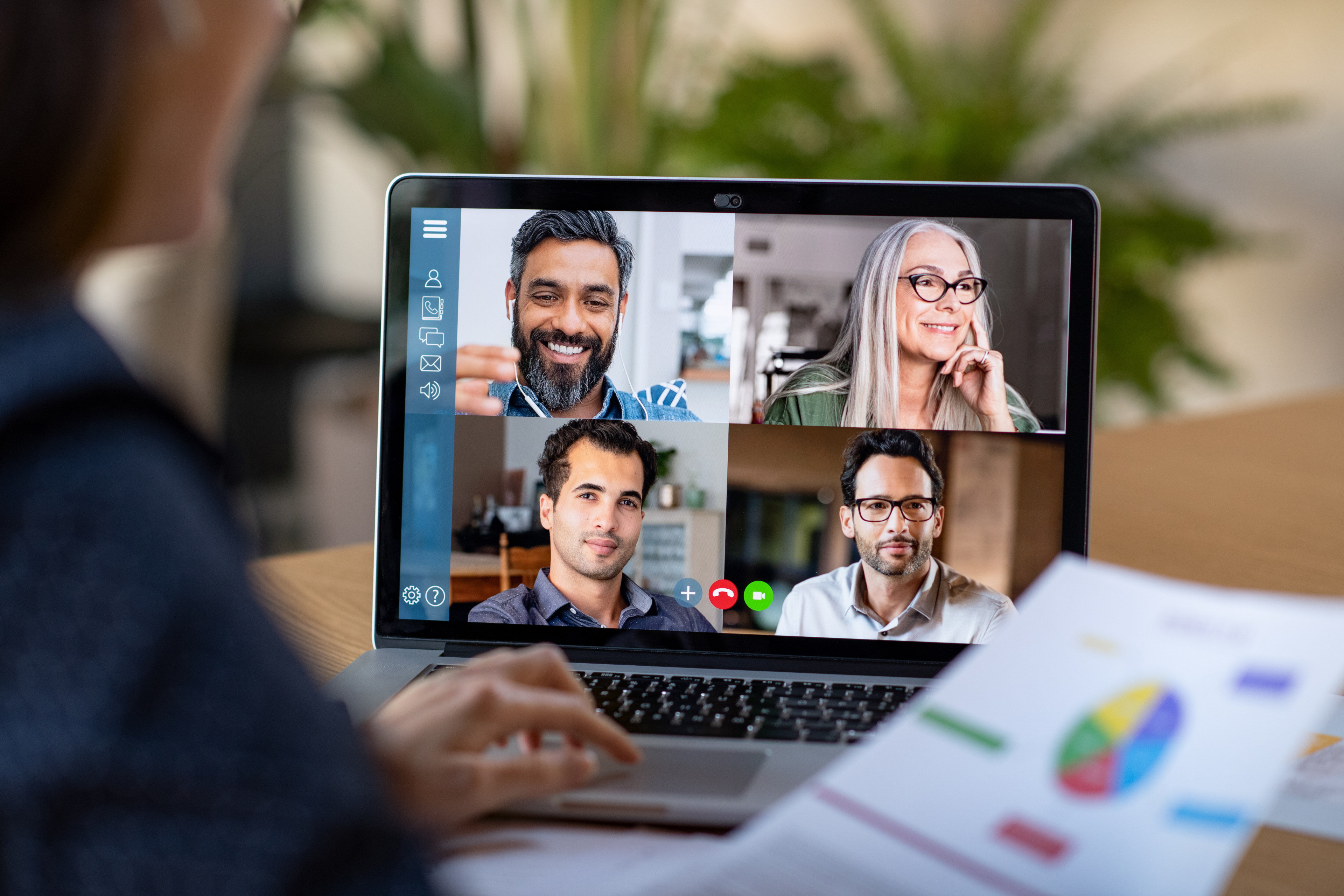 Business woman talking to her colleagues in video conference