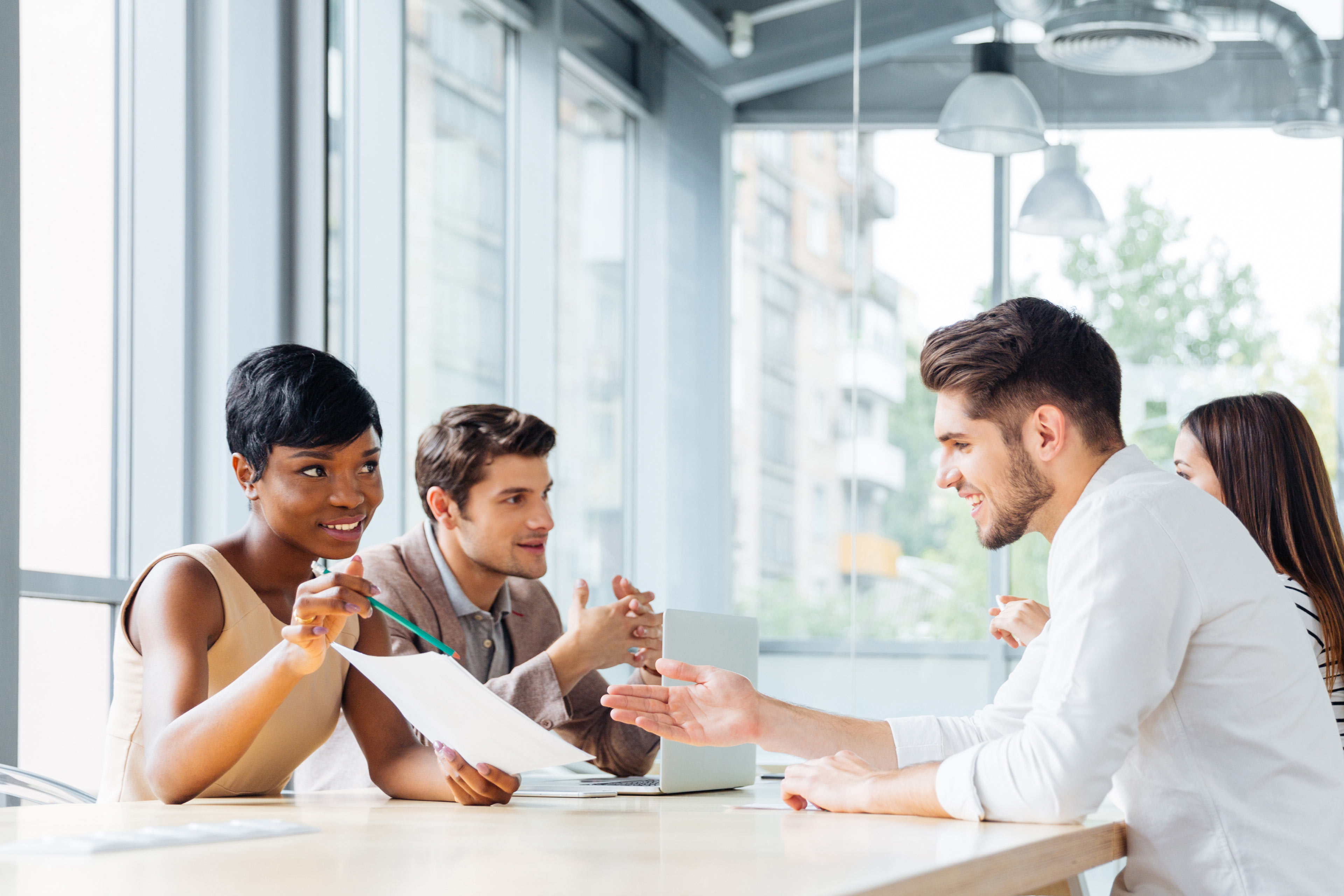Businesspeople discussing new project at business meeting in office