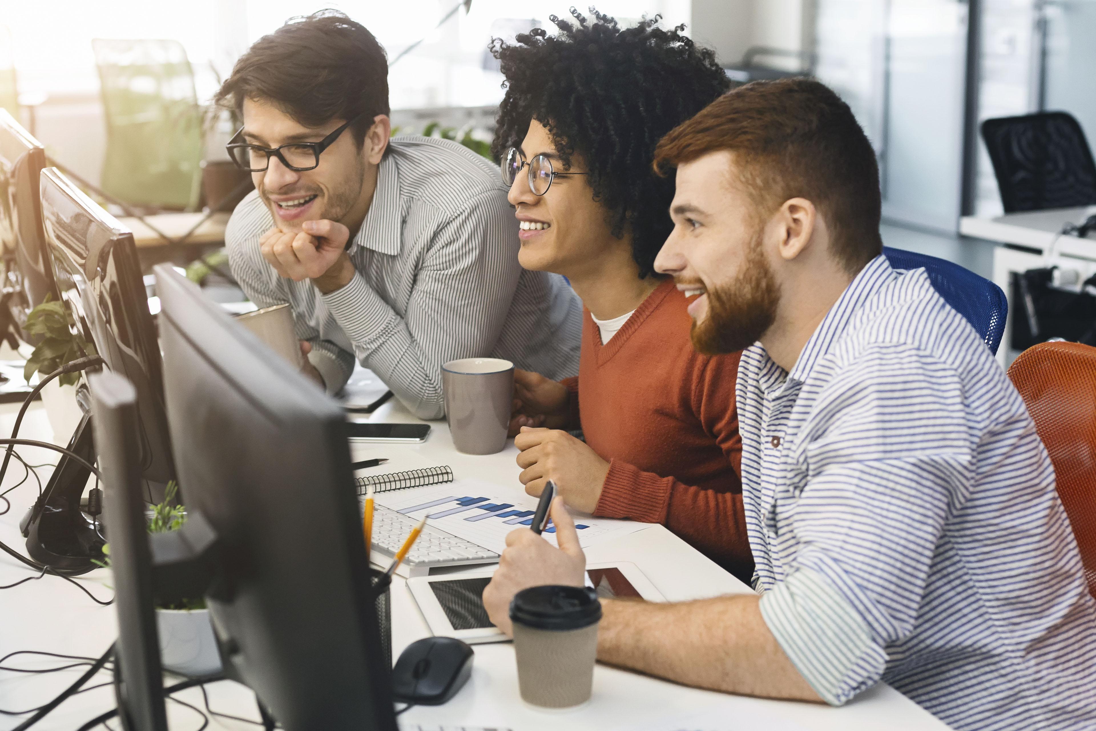 Team of program engineers working at office