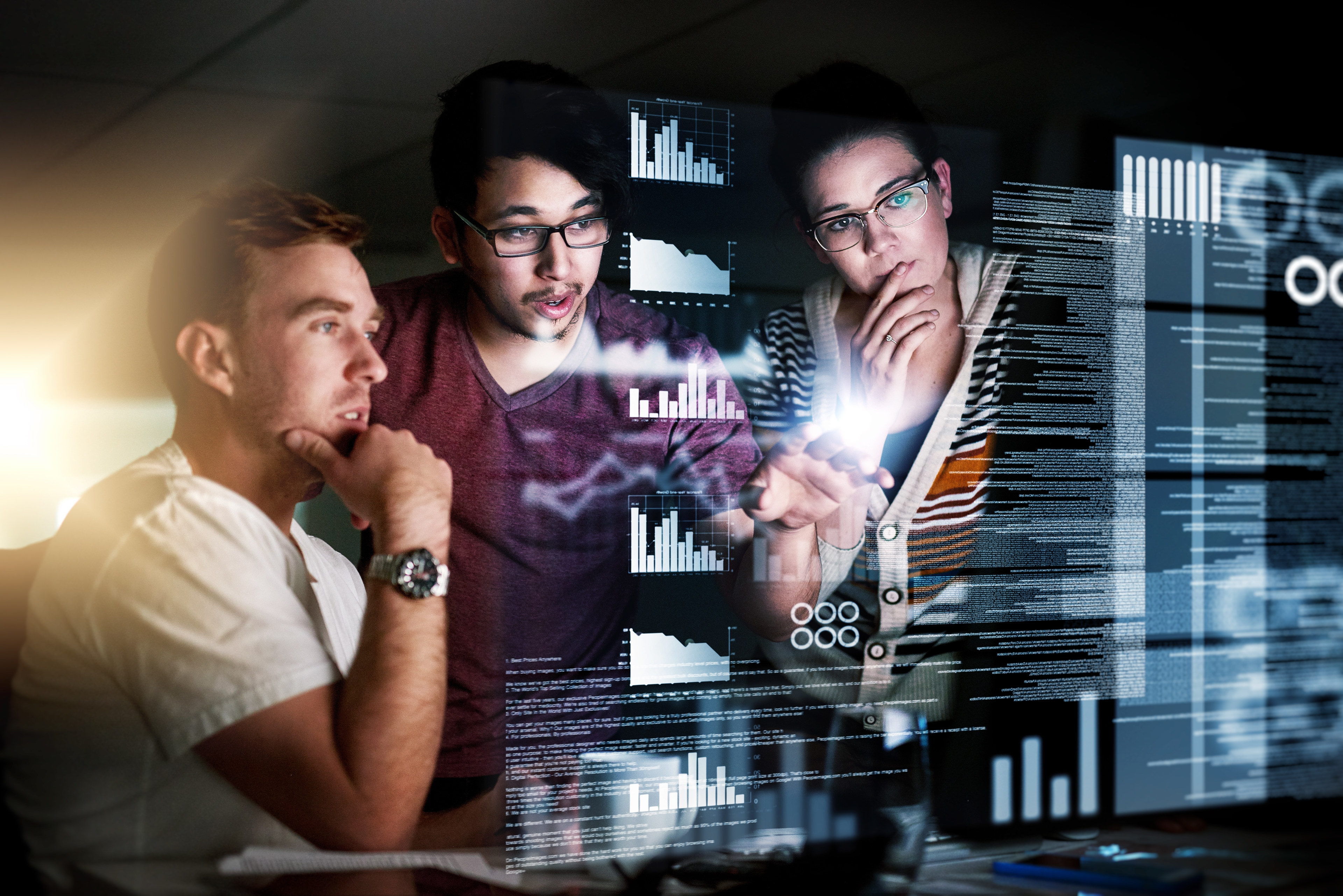 Three people reviewing code