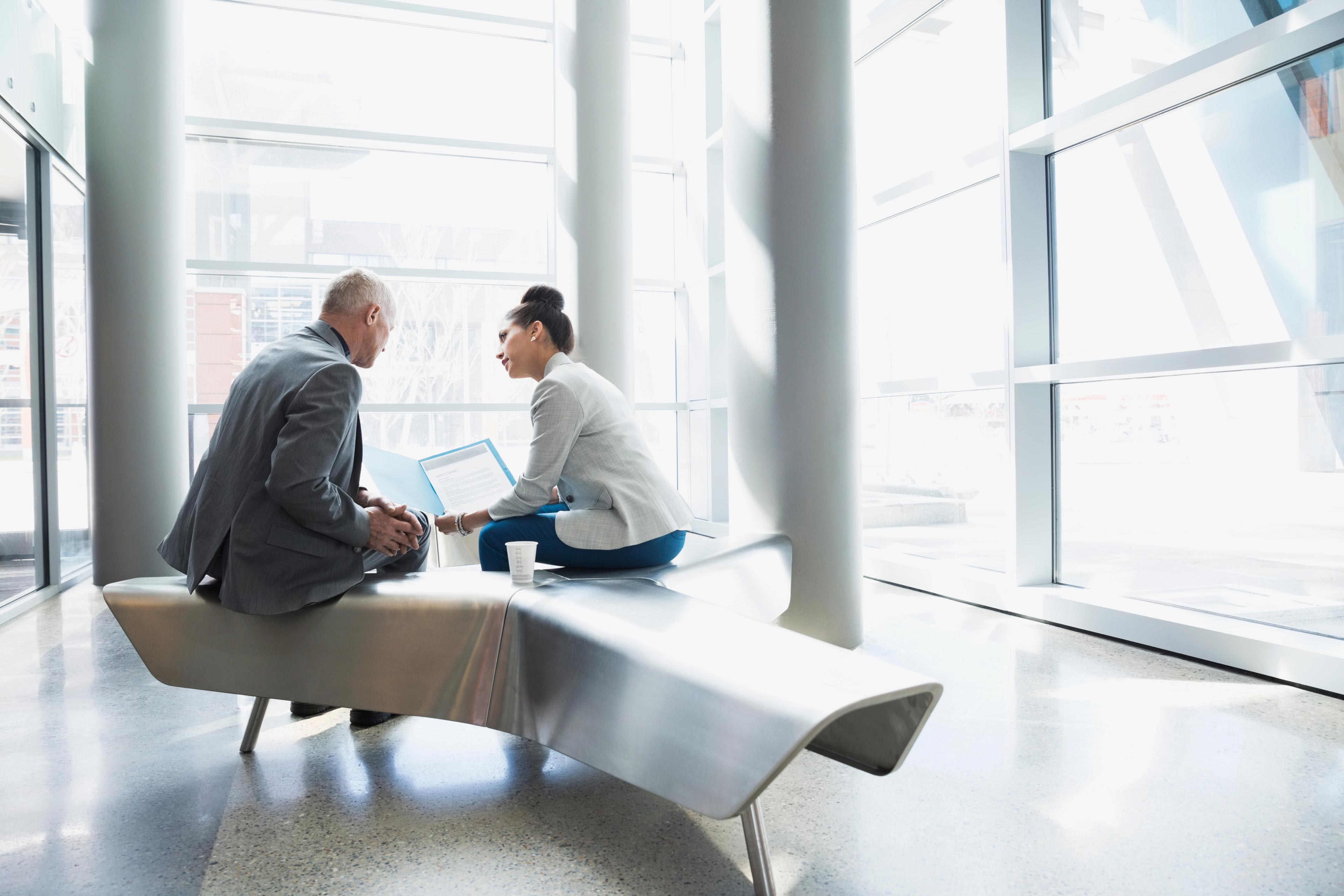 Two people talking in lobby