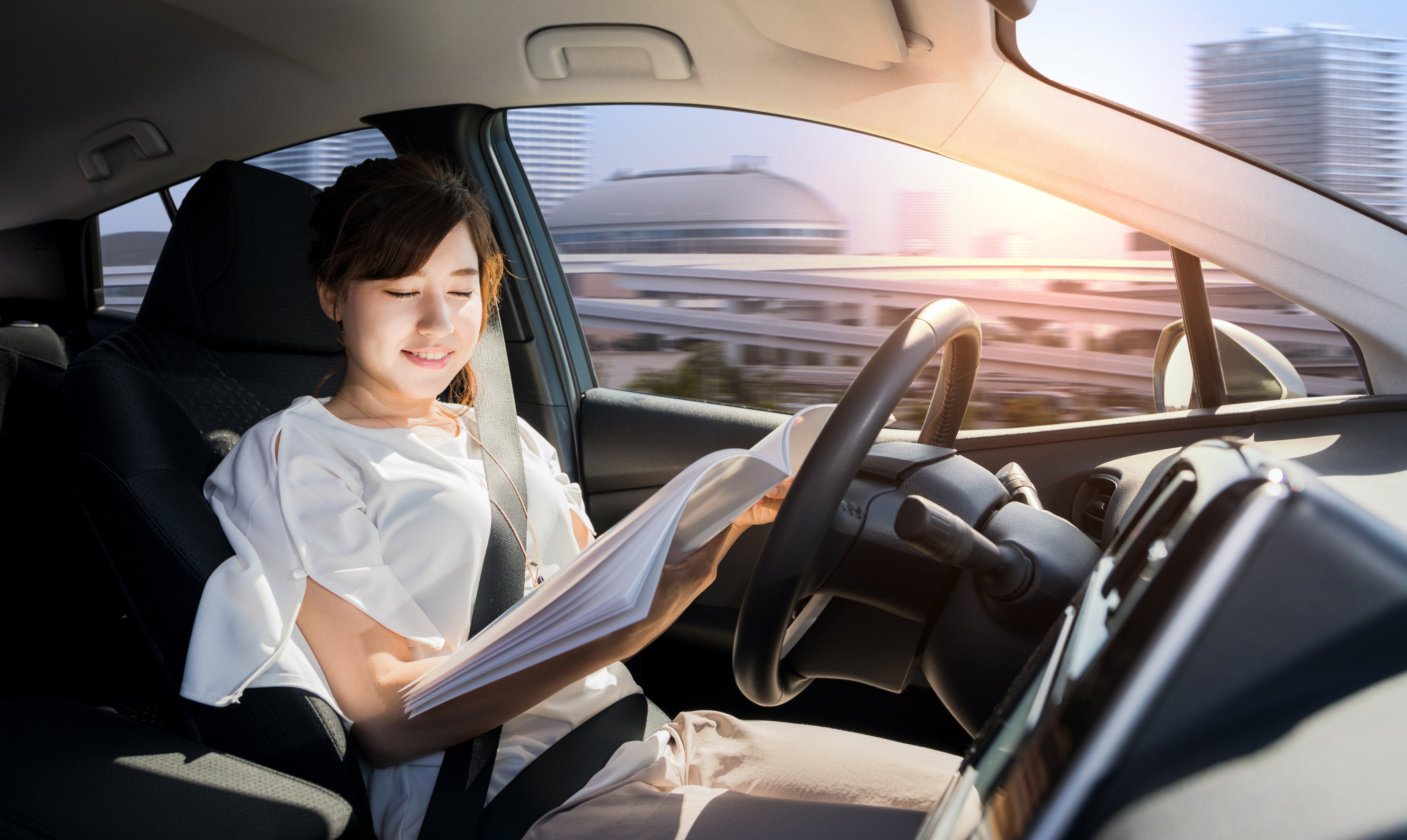 Woman reading in self-driving vehicle