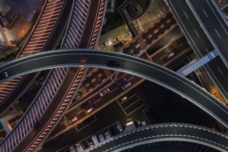 Aerial view of offramp at night big highway system
