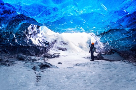 Hiker in ice cave