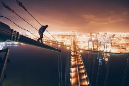 ey-man-standingon-cable-of-bridge-ch2