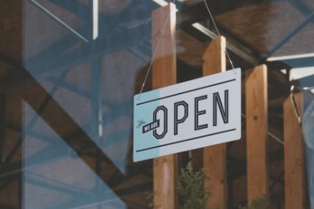 ey-open-sign-in-business-window