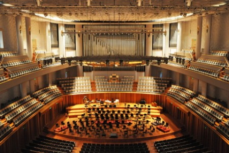 Seatings for a philharmonic orchestra in an empty concert hall