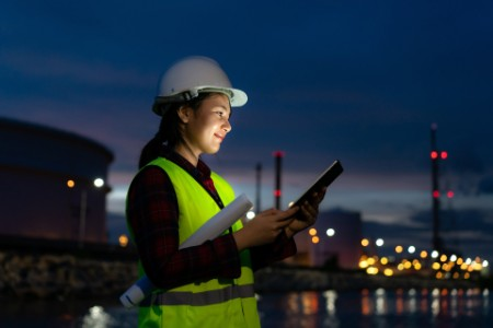 EY - Woman petrochemical engineer working at night