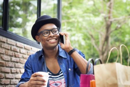 Man on phone drinking coffee
