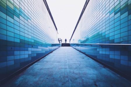 EY - Man-walking-on-footpath-amidst-surrounding-wall