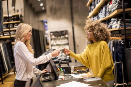 EY - Woman customer paying with credit card