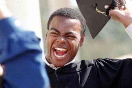 Happy man graduating