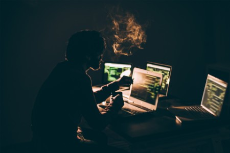 Hacker smoking and working