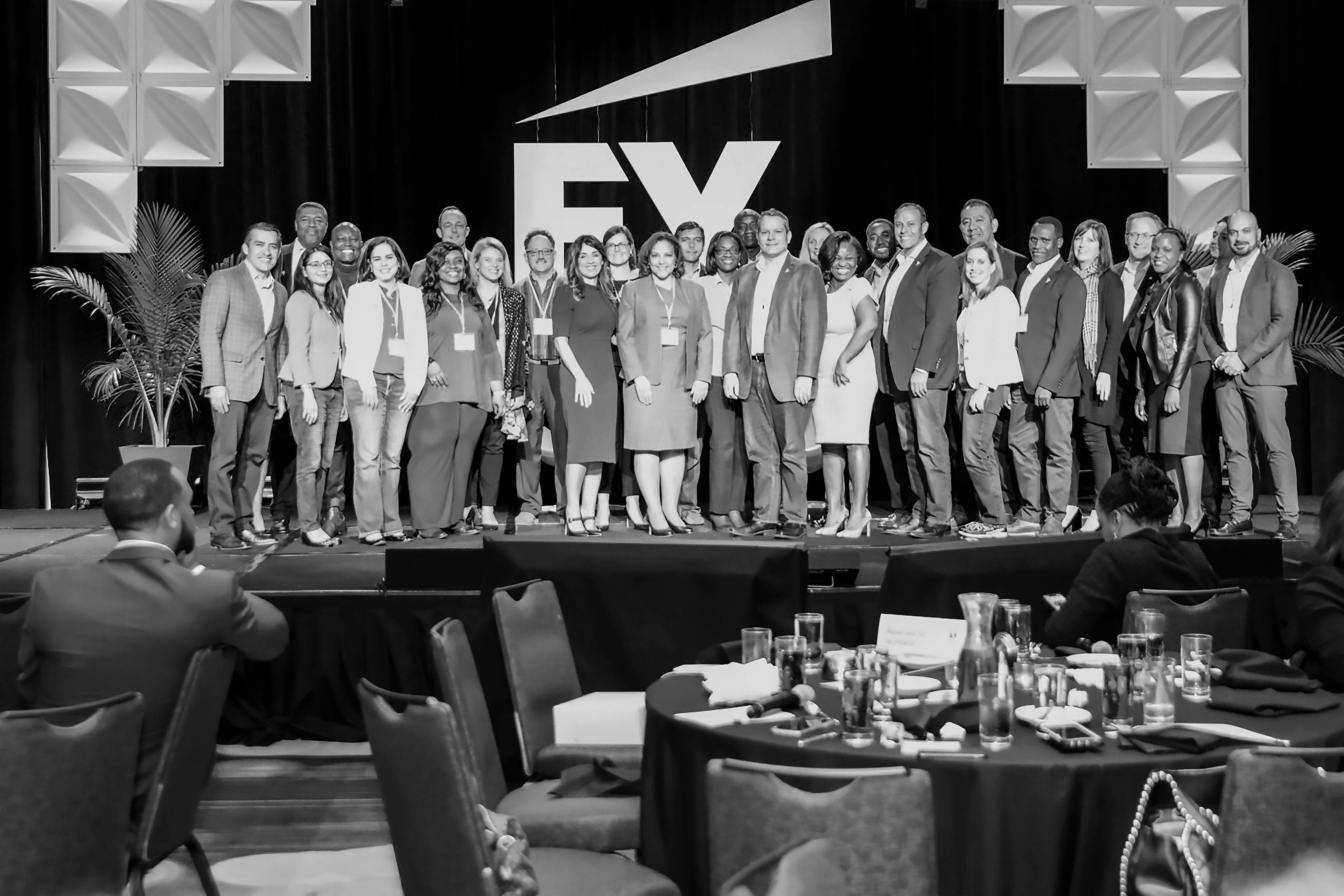 EY - Diverse group standing on stage