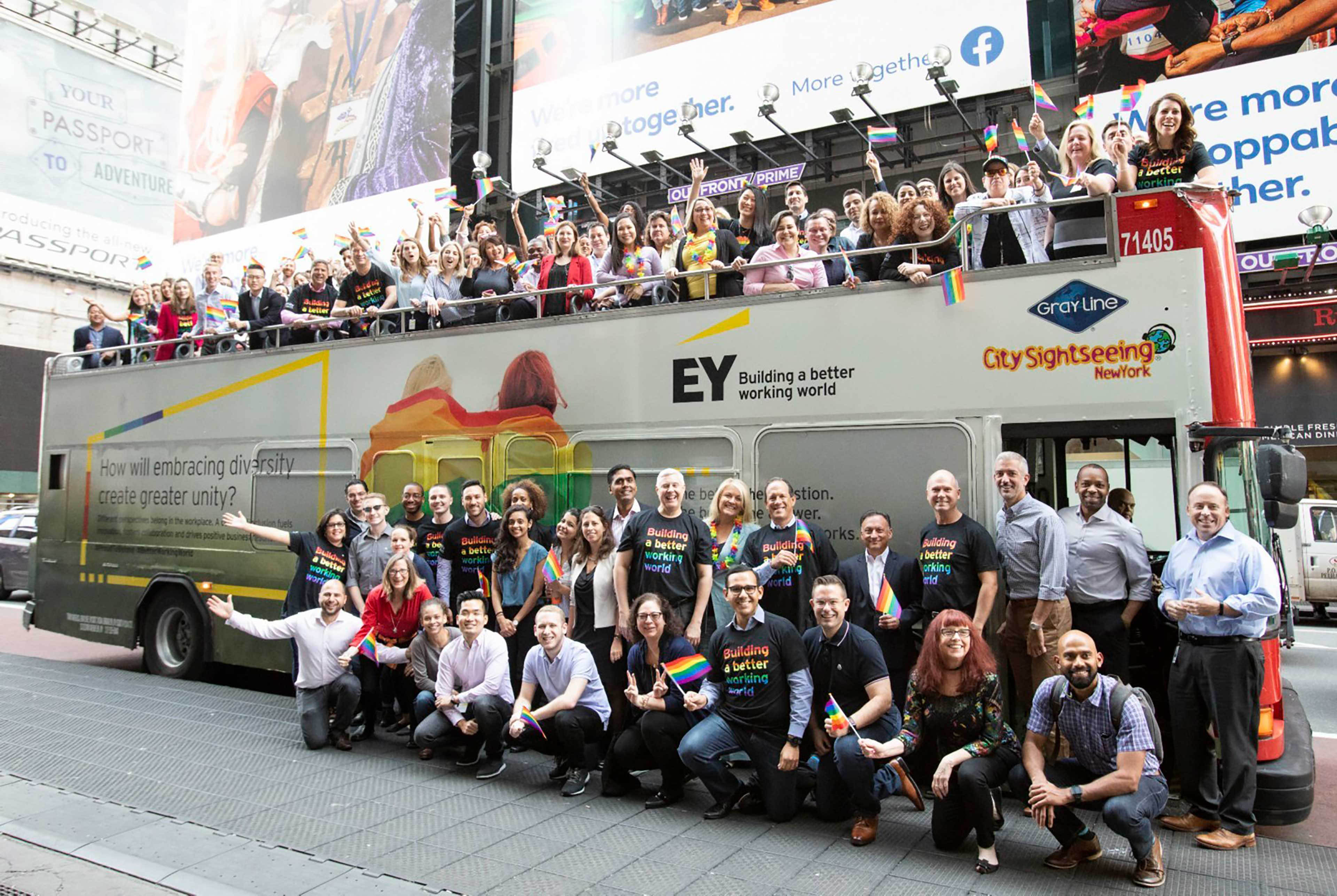EY - Group standing in front of unity branded bus