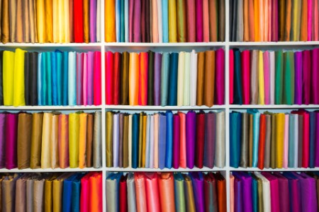 EY - Shelf-of-colored-fabric