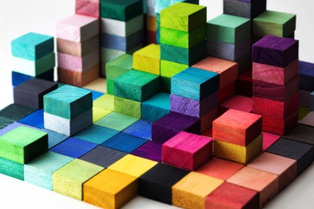 EY - Stacked-multi-colored-wooden-blocks