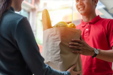 Woman getting grocery home delivery