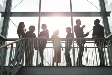 Business people talking on staircase