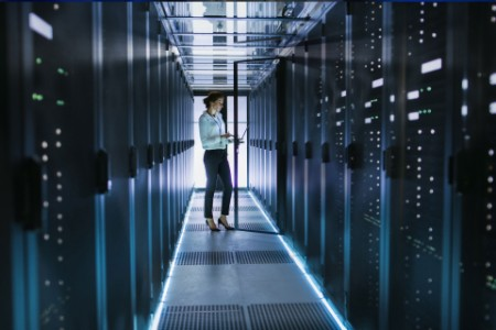 ey-female-server-technician-stands-in-data-center-corridor-chapter-2
