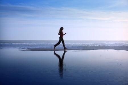 EY - Woman jogging on beach