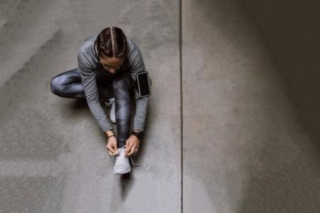 Women tying shoes