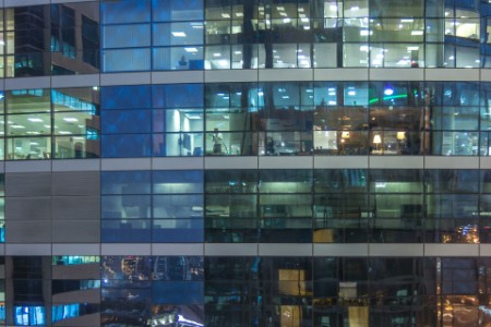 Glowing windows of office building