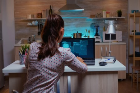 EY - Woman coding at home