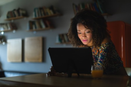 woman working with digital tablet late at night