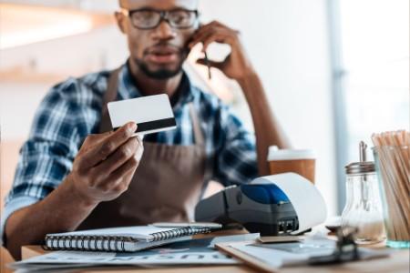 ey-man-working-credit-card-reader