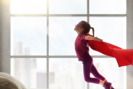 girl superhero flying
