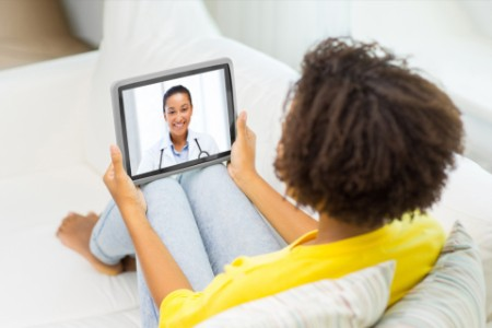 Patient having video chat with doctor on tablet