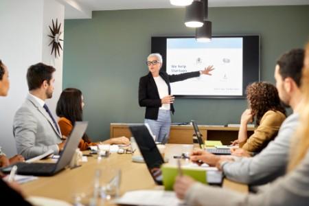 Woman presenting strategy board
