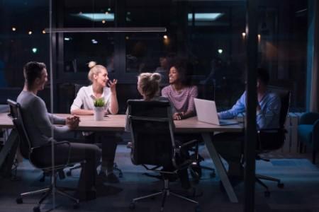 Multiethnic business team meeting in night office