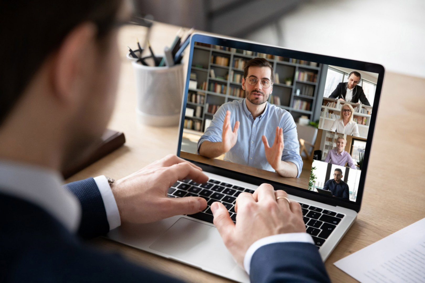 EY - Business man participating in a videocall