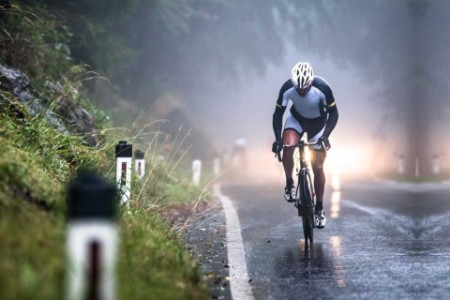 Man riding bike in the rain