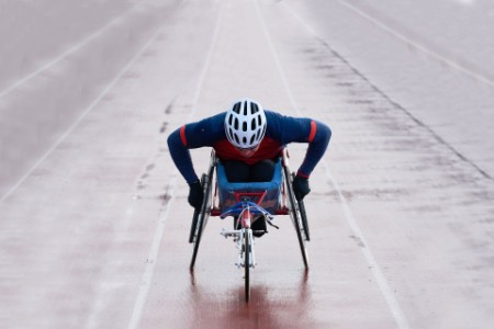 EY - Paraplegic male athlete training speed