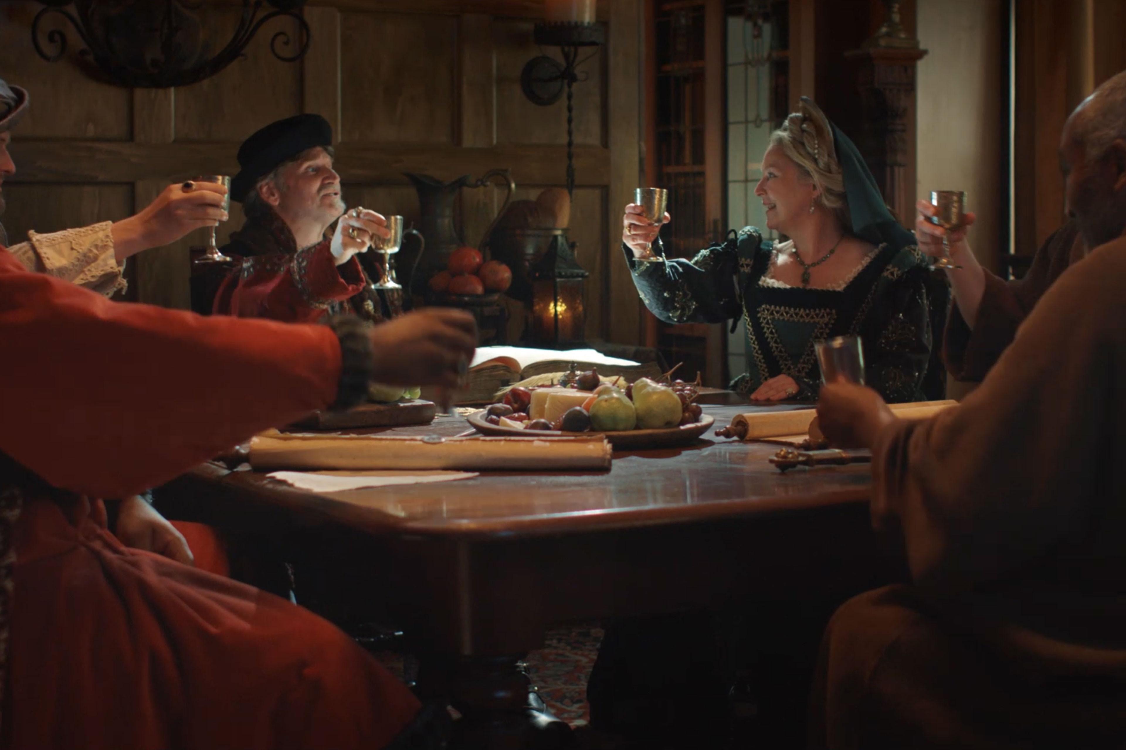 Renaissance era people toasting glasses