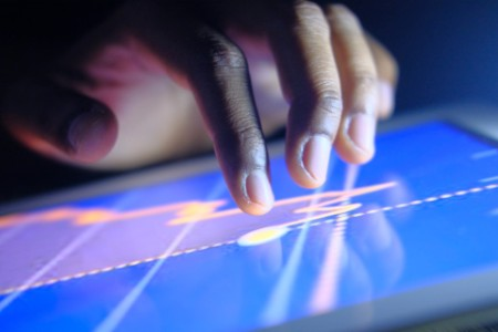 Close-up of man hands touching digital tablet with business diagram