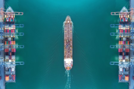 Aerial view panoramic oil tanker moving pass sea port warehouse and container ship or crane ship working for delivery containers shipment.