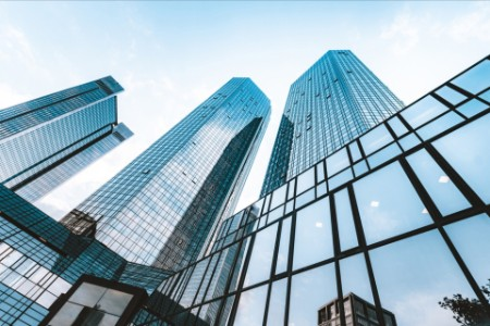 Looking upward at glass buildings