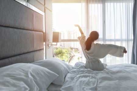 Woman streching in hotel room