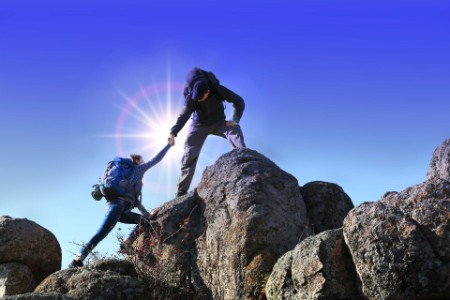 EY - Climbers helping eachother