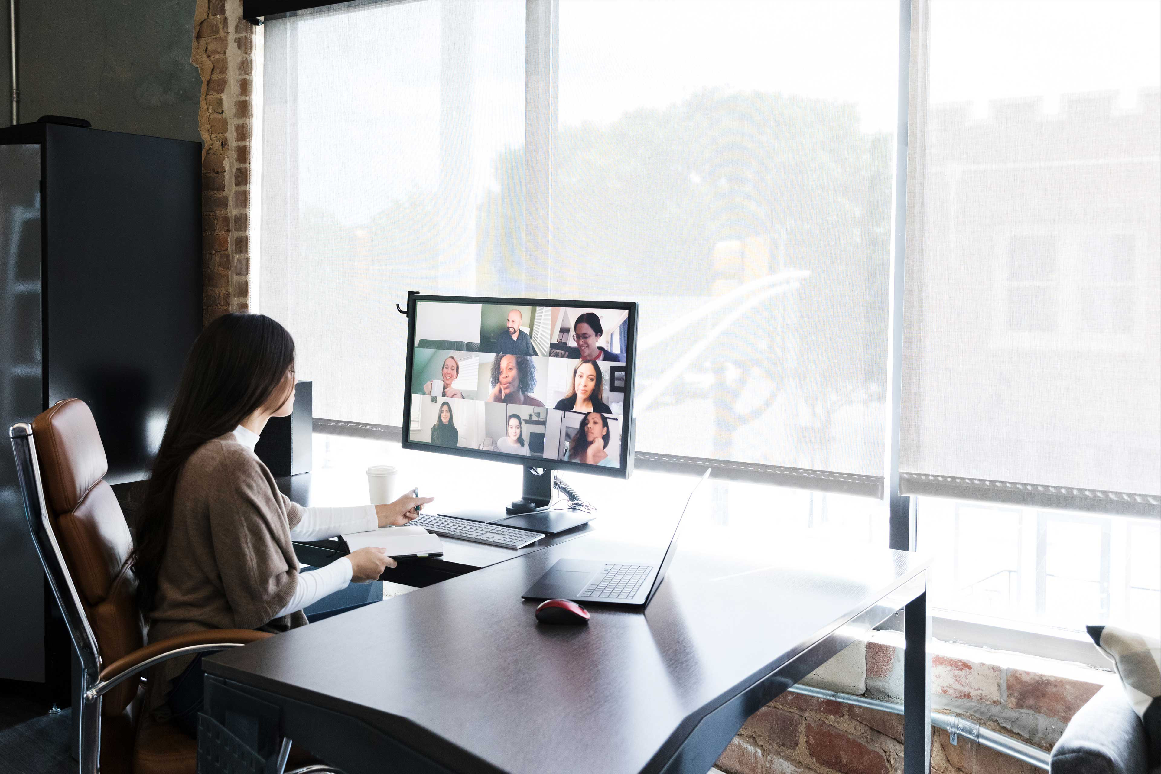 Woman meets with colleagues virtually