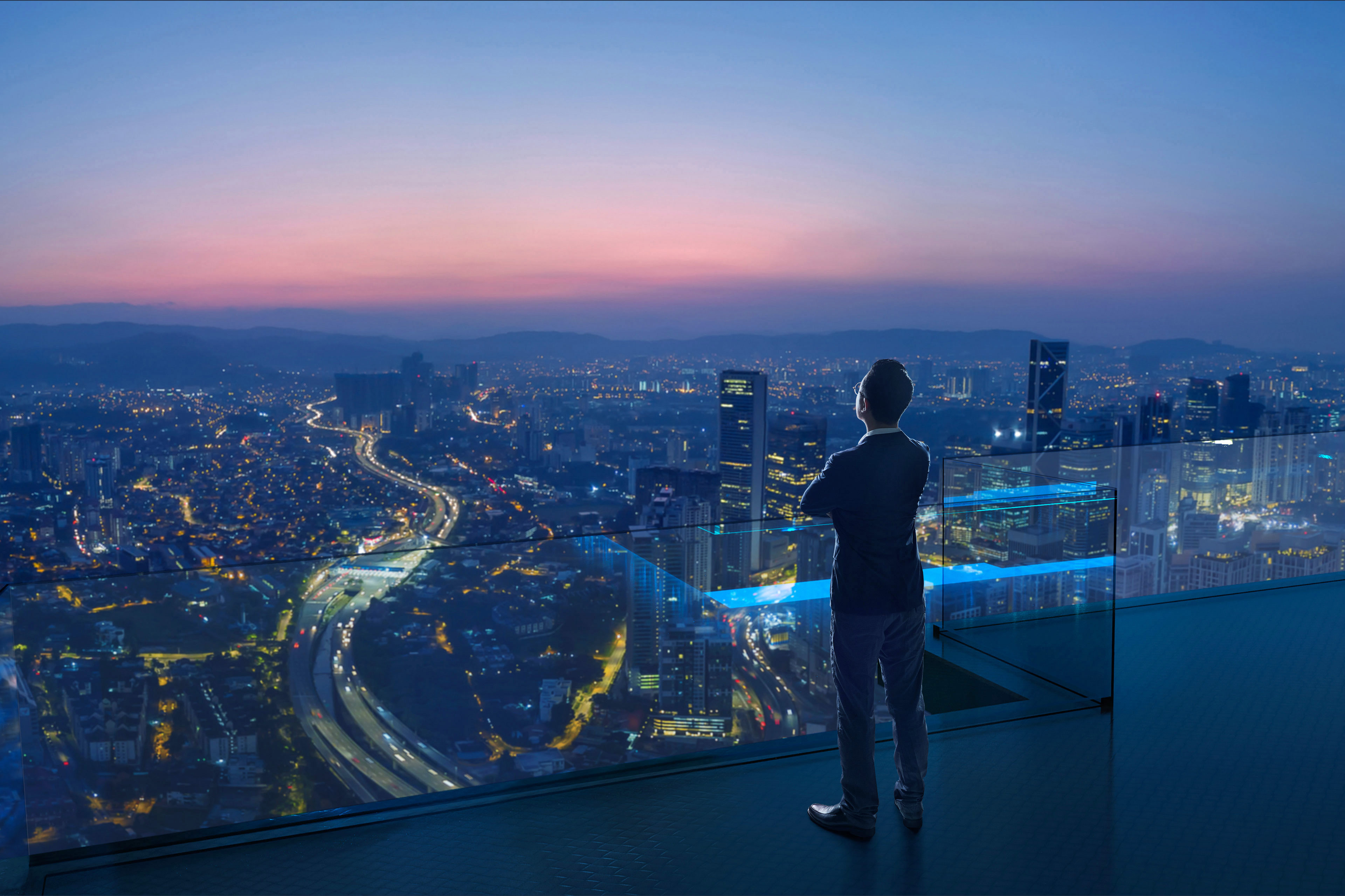 man looking out to view of city