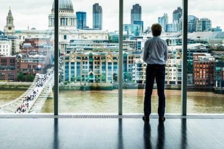 Businessman looks at the London skyline