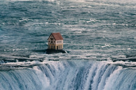 House on top of a waterfall
