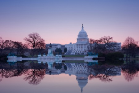 Sunrise behind the dome of the US Capitol